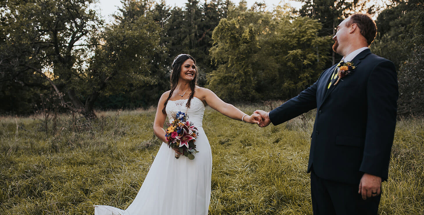 Finger Lakes Getaways - Smiling elopement couple holding hands