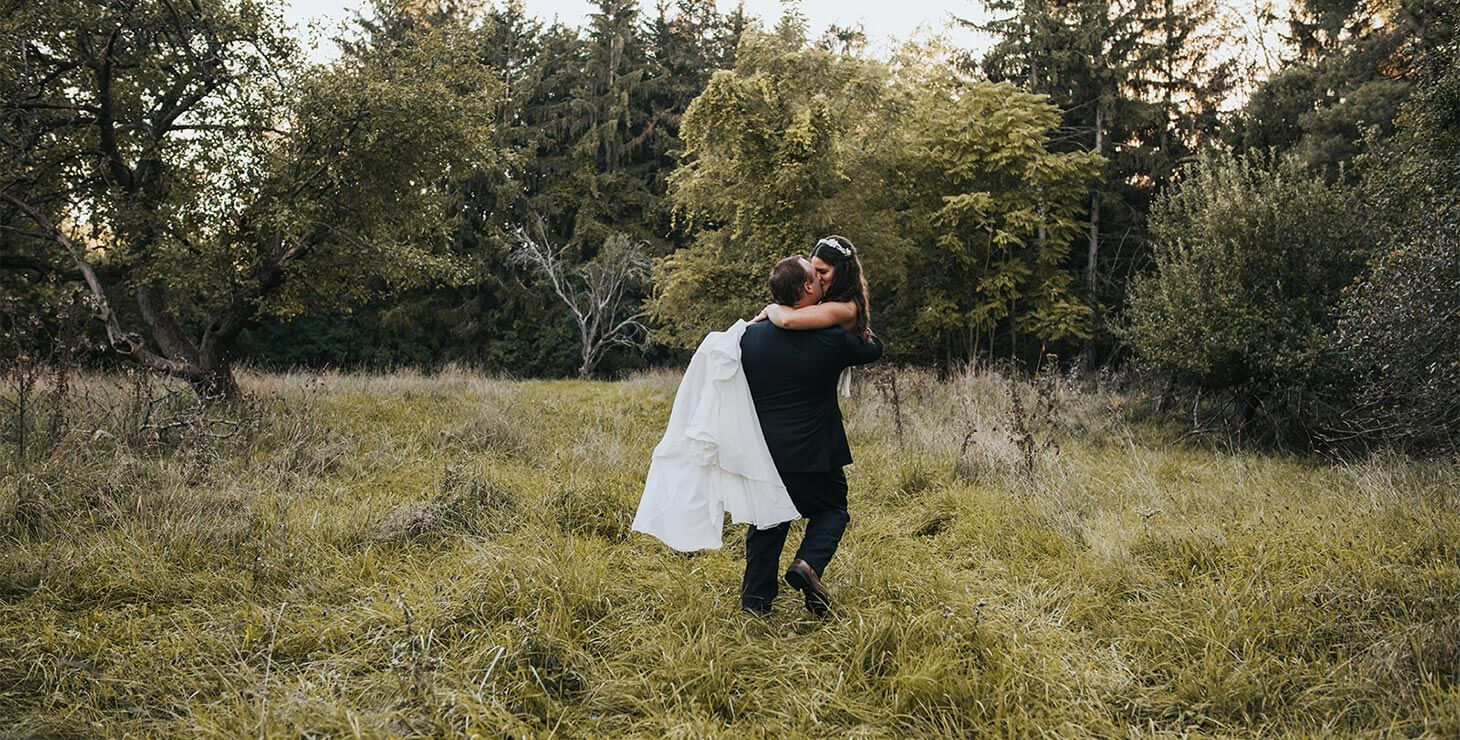 Finger Lakes Elopement - Groom carrying his Bride