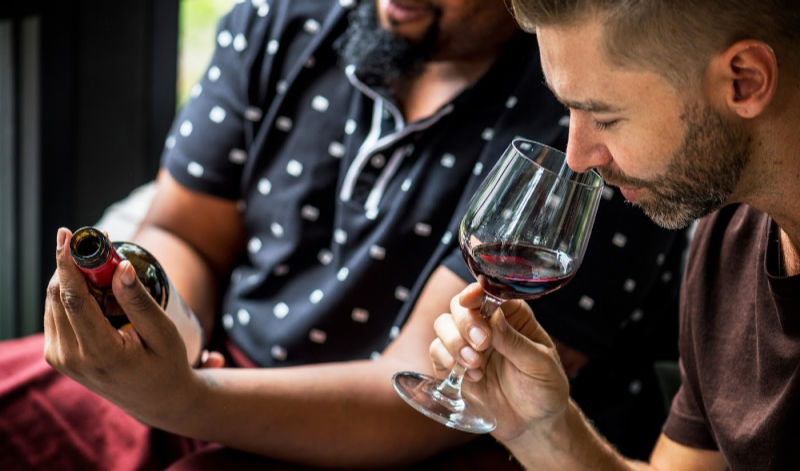 tow men tasting wine