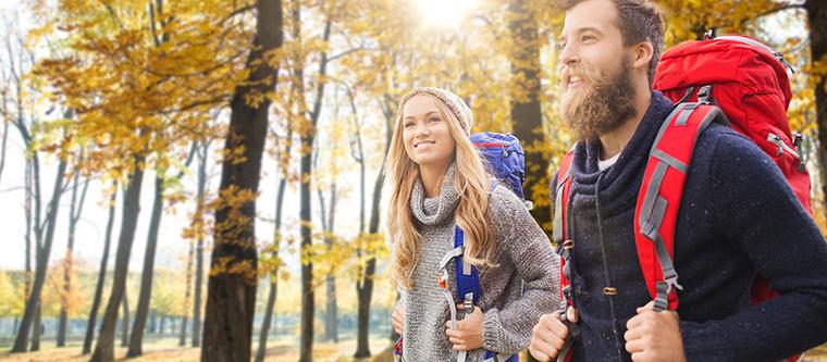 Happy couple enjoy a autumn hike in upstate NY
