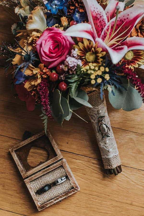 bouquet and small box with wedding rings